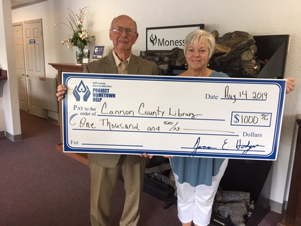 MTNG's Project Hometown Help donates to library