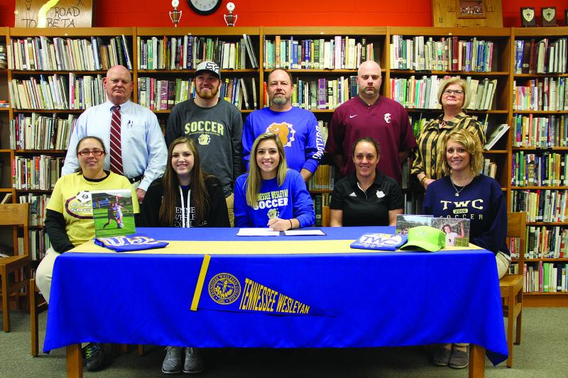 Signs soccer scholarship | Livia Walker