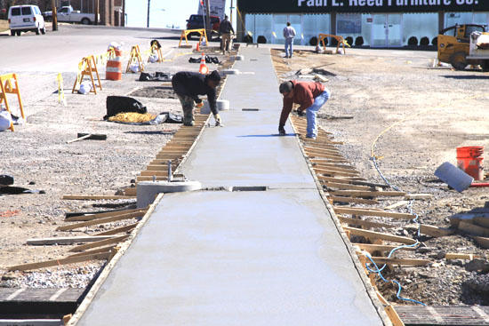City Sidewalks, Busy Workers As Courthouse Work Progresses