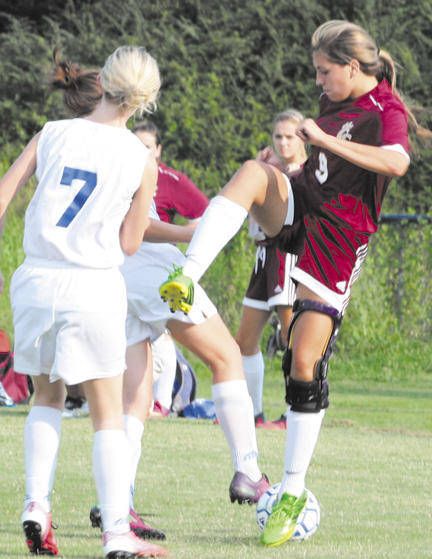 Walker's hat trick propels Lionettes to win