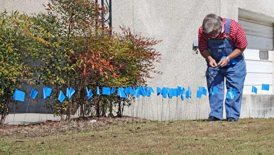 Why Are There Blue Ribbons On The Child Advocacy Center Lawn?