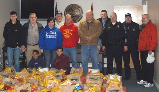 Neighborhood Watch, Law Officers Deliver Food To Needy Families
