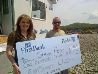 FirstBank Presents Woodbury Customer With $1,000