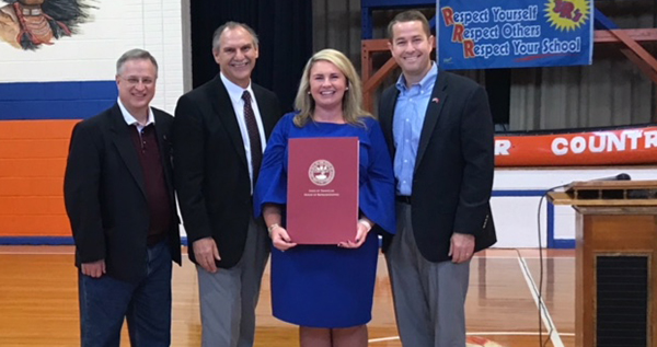 Boyd honors Woodland's Angela Cossey