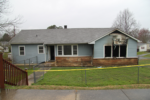 Home up for auction catches fire