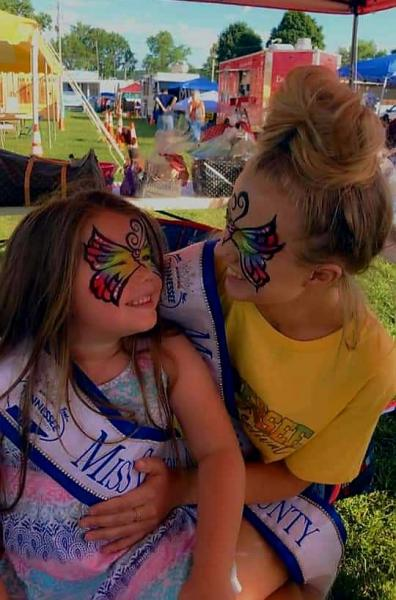 Two former Miss Cannon County Fair Pageant winners Willow Gnida and Monica Carlton get face painted up