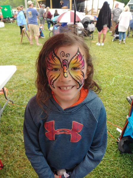 Alaiyh Duncan gets her face painted at the fair.