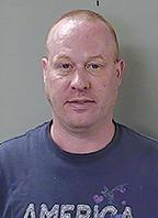 Man charged with shooting neighbor