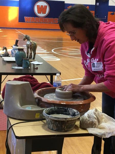 Currie Sculpts Clay With Woodland Students