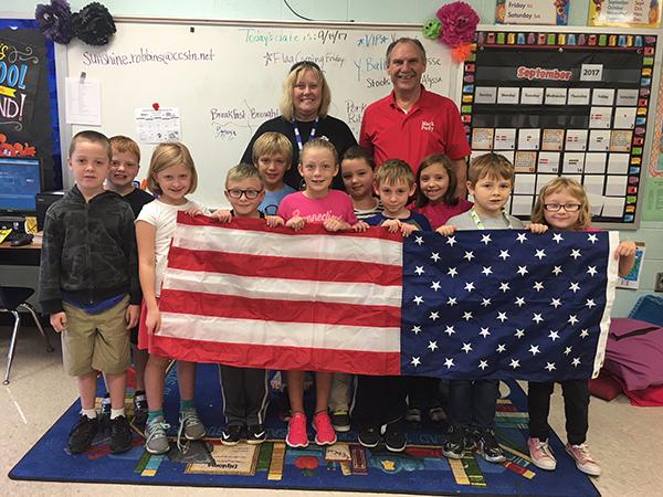 Pody donates flag to Auburn School