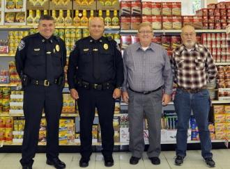 Neighborhood Watch Collects For Christmas Food Drive